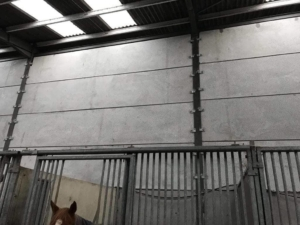 Pre-stressed wall panels for horse stables